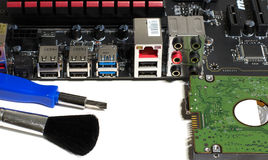 Kind of motherboard on the side with tools and parts for repair.  royalty free stock images