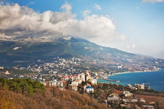 Kind from mountain on a seaside city Stock Photo