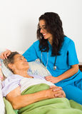 Kind Nurse with Elderly Stock Photos