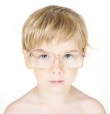 Kind in oogglazen. Sluit omhoog portret stock foto