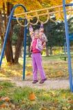 Kind op de speelplaats Stock Fotografie