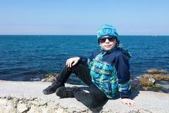 Kind op dijk van Sebastopol stock afbeeldingen