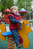 Kind op een de lentepaard Royalty-vrije Stock Foto's