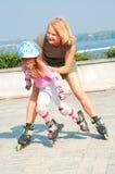 Kind op gealigneerde rollerbladevleten Royalty-vrije Stock Foto