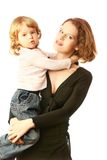 Kind op moederhanden Stock Foto
