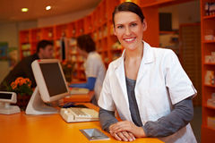 Kind pharmacist behind counter Stock Photo