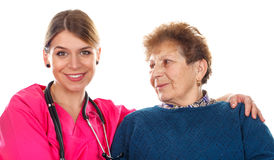 Kind physician. Picture of an old lady with her physician - isolated background Royalty Free Stock Photography