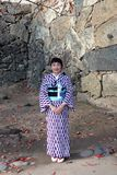Kind and pleasant of receptionist in Kimono dress on purple and white color at Himeji Castle. royalty free stock photography