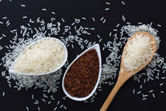 3 kind of raw Thai rice Thai Jasmine rice, Glutinous/Sticky Rice, Brown Rice in white cups Royalty Free Stock Photography