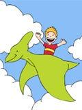 Kind reitet einen Dinosaurier Lizenzfreies Stockfoto