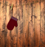 Kind-` s Handschuh auf einem hölzernen Hintergrund Weihnachten Neues Jahr T Lizenzfreie Stockfotos