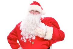 Kind Santa Claus carrying big bag, isolated on white background.  Royalty Free Stock Photos
