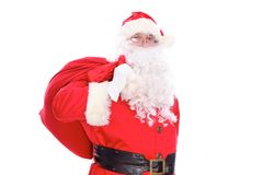 Kind Santa Claus carrying big bag, isolated on white background.  Royalty Free Stock Photography