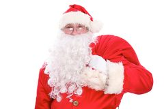 Kind Santa Claus carrying big bag, isolated on white background.  Stock Photography