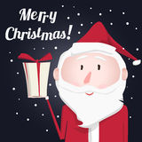 Kind Santa Claus with a gift Stock Photo