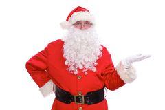 Kind Santa Claus pointing in white blank sign, isolated on white background.  Stock Photography