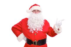 Kind Santa Claus pointing in white blank sign, isolated on white background.  Stock Images