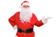 Kind Santa Claus pointing in white blank sign, isolated on white background.  Royalty Free Stock Photos