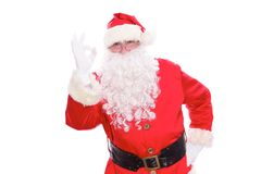 Kind Santa Claus showing ok, isolated on white background.  Royalty Free Stock Photo