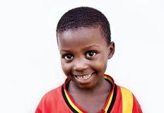 Kind in school in Oeganda stock foto