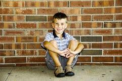Kind-Sitzen Lizenzfreies Stockbild
