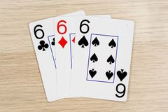 3 of a kind sixes 6 - casino playing poker cards. 3 of a kind sixes 6 - winning hand of gambling casino poker playing cards on a table stock photography