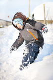Kind in sneeuw Stock Foto