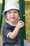 Kind am Spielplatz Stockfoto