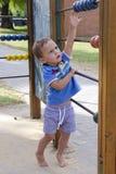 Kind am Spielplatz Lizenzfreie Stockfotos