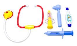 Kind spielt Werkzeugsatz der medizinischen Ausrüstung Stockfotografie