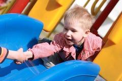 Kind strech heraus die Hand, Hilfen Lizenzfreie Stockbilder