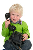 Kind am Telefon Stockfoto