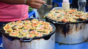 Kind of Thai sweetmeat Kanom Krok Seafood stock footage