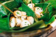 Kind of Thai sweetmeat situated banana leaf royalty free stock photos
