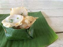 Kind of thai sweetmeat Thai desserts in banana leaf. royalty free stock photography