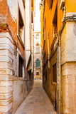 Kind of typical narrow street in the old town. Venice. Italy Stock Photo