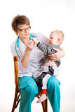 Kind und Doktor Stockfoto
