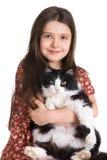 Kind und flaumige Katze Lizenzfreie Stockbilder