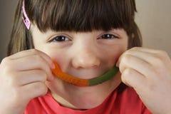 Kind und Gumdrops Stockfotografie