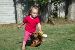 Kind und Haustier Stockfotos