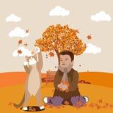 Kind und Katze, die Blätter spielen stockfotos