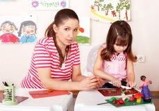 Kind- und Lehrerform vom Plasticine. Stockfotografie