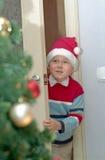 Kind- und Weihnachtsbaum Stockfotos