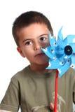 Kind und Windmühle Stockbilder