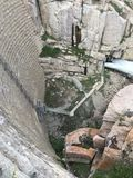 Kind way down. 200 foot drop to the bottom of pathfinder dam Stock Image