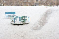Kind of winter in a small childrens playground filled with ice slides Royalty Free Stock Image
