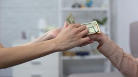 Kind woman putting euro banknote in mature female hand, charity fund, donation