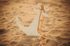Kindanker op het zand Stock Foto's