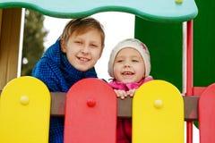 Kinder auf dem playgorund Stockfotografie