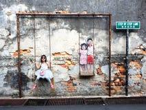 Kinder auf der Schwingen-Straße Art Piece in Georgetown, Penang, MA Stockfoto